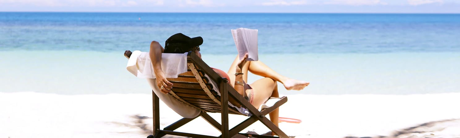 vacation,beach,read,book,sit,hat,sea,sand,noon,sun,summer,hot